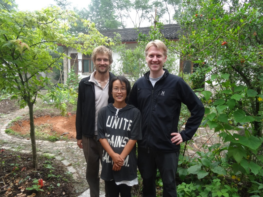 Thomas, Xiao Zhu and Goran in the courtyard.