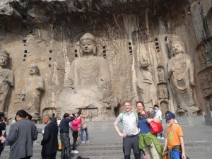 Erik snaps a group photo in front of the main Buddha.