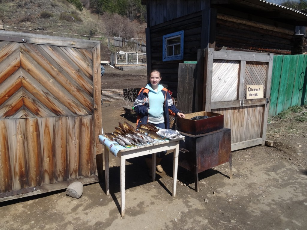 Lena sells smoked Omul - a salmon fish only found in Baikal.